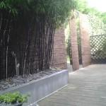 Mélange de matières : bambou, paillettes d'ardoise, zinc et bois